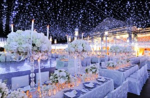 how-to-create-a-winter-wonderland-wedding-reception-decor-planning-high-floral-topiaries-blue-lighting__full-carousel